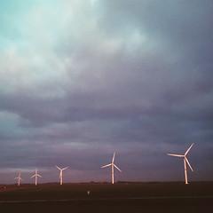 Wind Power (Olly Denton) Tags: light sunset sky 6 news apple work drive evening mac driving power belgium wind five photojournalism eu series ios journalism fromcar turbines currentaffairs iphone verlaine windturbines vsco iphone6 vscocam