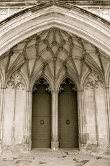 Main Door of Winchester Cathedral (Jacek Wojnarowski Photography) Tags: door old uk england west building vertical architecture facade europe arch cathedral outdoor religion landmark hampshire front retro keystone aged christianity spirituality winchester sepiatone blackandwhitephotography gothicarchitecture religiousbuildings 6x4 splittoning sepiaphoto englishgothicarchitecture religiousequipment