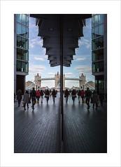 London Reflected #3 (andyrousephotography) Tags: people building london glass wall thames towerbridge reflections image double symmetry reflected batman symmetrical pwc morelondonriverside