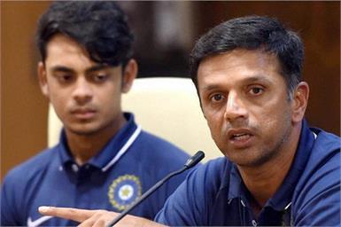 Mumbai: India's Under-19 coach Rahul Dravid along with team captain Ishan Kishan (L) during a press conference in Mumbai