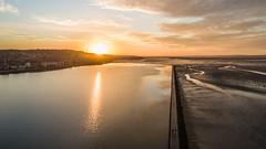 This morning's sunrise (Roger Ellison) Tags: morning orange sunrise calm dee westkirby westkirbymarinelake