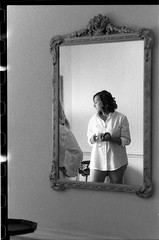 AmandaJaysonFilm_338 (Johnny Martyr) Tags: she wedding portrait blackandwhite bw woman reflection film girl female composition 35mm mirror nikon thought quiet personal kodak trix grain photojournalism gravity processing bridesmaid reflective moment nikkor leak contemplative sprockets dressshirt buttondownshirt buttonupshirt mensshirt prebridal