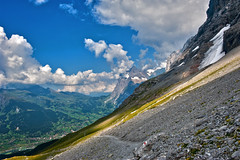 Hiking the Eiger Trail,a view to  First Grindelwald The Grosse Scheidegg and the Wetterhorn. no. 7902. (Izakigur) Tags: road summer alps love clouds alpes liberty schweiz europa suiza hiking swiss feel first happiness bern grindelwald helvetia berne eiger ch berna berneroberland wetterhorn grossescheidegg lasuisse kantonbern eigertrail cantonofbern suisia laventuresuisse switzzera
