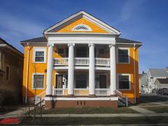 Bright Orange House in Walker's Point (cohodas208c) Tags: orange neighborhood milwaukee porch victorianhouse walkerspoint