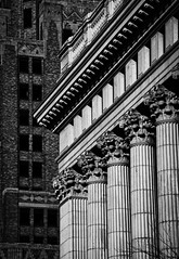 Mutual Support (Carl's Captures) Tags: city winter urban building classic monochrome lines vertical architecture contrast landscape outdoors morninglight support cityscape order shadows geometry patterns capital columns frieze structure diagonal february posts pillars parallel pediment corporateheadquarters milwaukeewisconsin volute tamron18270 nikond5100 lightroom5 northwesternmutuallifeinsurancecompany