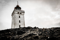 Old lighthouse (daniel_munch) Tags: old windows sky lighthouse architecture clouds sand rocks bricks perspective dirty worn battered