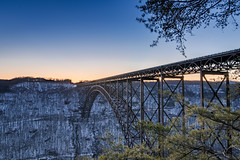 crossing sunset (almostsummersky) Tags: bridge trees winter sunset sky snow metal clouds forest landscape us highway arch unitedstates steel horizon scenic wv westvirginia gorge bluehour overlook span newrivergorgebridge fayetteville newriver newrivergorge singlespan singlespanarch