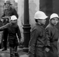On the platform (theirhistory) Tags: girls boys hat station kids children shoes war europe wwii railway trains ww2 soldiers raincoats germans