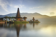 Ulun Danu temple Bali (Jacada Travel) Tags: old morning travel blue sunset wallpaper sky bali lake mountains building green history tourism nature water beautiful architecture sunrise indonesia landscape asian religious island temple ancient scenery worship asia god background traditional religion scenic culture peaceful landmark tourist holy exotic sacred tropical tradition oriental spiritual hindu hinduism pura ulun danu balinese lightbeam bratan beratan
