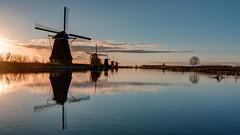 Dawn at Kinderdijk - 2 (m0nt2) Tags: sky orange sunlight holland reflection nature water windmill clouds sunrise landscape dawn spring waterfront thenetherlands tokina bluehour lente wrinkles 1224mm f4 kinderdijk d300s