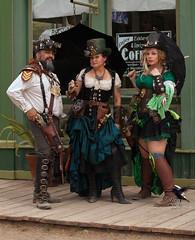 Steampunk Main Street 328 (thePhotographerRaVen) Tags: arizona fashion gun tucson goggles fantasy gears gadgets wildwest weapons steampunk oldtucson steampunkfashion fantasyfashion photosbyraven wildweststeampunk wwwc5