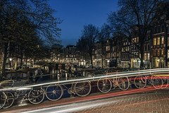 (angheloflores) Tags: street blue houses sky urban holland colors amsterdam night lights canal cityscape trails explore