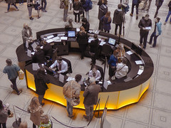 The Enquiry Desk (Steve Taylor (Photography)) Tags: uk greatbritain blue england people woman brown man men london girl yellow museum lady umbrella tile table women floor desk unitedkingdom screen va gb information poses victoriaandalbert enquiry selectivecolour