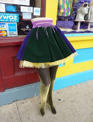 New Orleans is different, especially during Mardi Gras season (Monceau) Tags: black mannequin yellow gold colorful purple bottom skirt half unusual nola stocking mardigras 14366