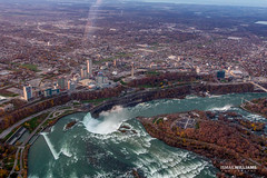 Niagara Sky Shot 2 (ismailwilliams) Tags: city bridge sunset sky usa mist ny newyork canada water plane canon buildings river landscape flow happy fly us stream niagara falls helicopter land damm maiden 60d