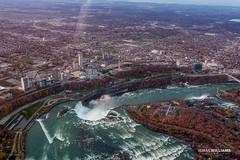 Niagara Sky Shot 2 (ismailwilliams) Tags: city bridge sunset sky usa mist ny newyork canada water plane canon buildings river landscape flow happy fly us stream niagara falls helicopter land damm maiden 60d