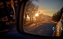 Looking Back On The Rising Sun! (Jo-Warming Up To The 80's :)) Tags: road morning sky sun sunrise rising jeep sidemirror lookingback
