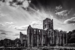 Beneath reverential skies (Anthony Plancherel) Tags: trees england sky blackandwhite bw cloud building tower church monochrome abbey grass stone skyline architecture clouds canon landscape outside blackwhite construction scenery arch outdoor decay yorkshire ruin landmark medieval monastery nave valley serene cloister reverence fountainsabbey sights northyorkshire solemn whiteclouds placeofworship famousplaces 550d