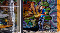 colorful openair office in san francisco (birdsongPics) Tags: sf sanfrancisco travel blue urban orange usa holiday man colors hat yellow wall handy graffiti restaurant office reisen colorful break fuji outdoor wand urlaub cellphone murals phonecall hut gelb brickwall mission fujifilm mann missiondistrict pause blau amerika reflexions westcoast bro ferien fujinon contrasts youngman openair eyecatcher farben kontraste farbenfroh westkste standardlens stdtisch jungermann xt1 blickfang streetphotographie backsteinmauer telefonanruf xf1855mm