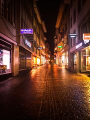 Night in the City (World-viewer) Tags: road street city travel signs streets reflection brick wet water beautiful stone architecture night canon reflections lights reflecting switzerland nice neon glow nightimages cityscape outdoor streetlamps pavement stones steps cobblestones cobble sidewalk shops streetsigns blocks lamps lucerne