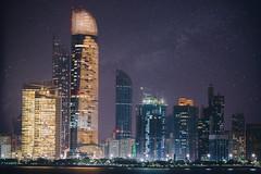 Abu Dhabi at night (Leonid Yaitskiy) Tags: travel light sky urban architecture night digital way stars long exposure capital uae emirates highrise destination abu dhabi milky blending coty khalidiya