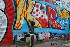 Caught in the act.... (hub en gerie) Tags: street streetart colour art netherlands schilder amsterdam wall paint grafitti outdoor kunst nederland vivid painter colourful verf muur kleurrijk kleur straatkunst artiest