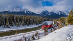 The Train || Morant's Curve, Lake Louise (anoopbrar) Tags: winter red white lake snow canada mountains cold nature beautiful clouds train river frozen artistic outdoor railway canadian louise national alberta peaks curve lakelouise bowriver morantscurve cptrain morants