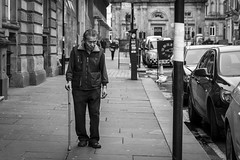 Moment Of Thought (Leanne Boulton) Tags: life street old city uk light shadow portrait people urban blackandwhite bw white man black detail male texture monochrome face canon walking 50mm mono scotland living blackwhite looking natural humanity outdoor expression glasgow candid culture streetphotography streetlife scene human elderly shade 7d stick aged society depth tone facial sociallandscape candidstreetphotography