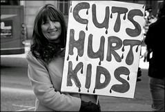 Austerity (* RICHARD M (Over 5 million views)) Tags: street signs liverpool portraits demo mono blackwhite politics portraiture scousers protests demonstrators protestors placards merseyside marches streetportraits demonstations marchers hardtimes toughtimes thecuts streetportraiture voxpop austerity voxpopuli liverpudlians writteninblood liverpooltownhall voiceofthepeople politicalprotests cutshurtkids governmentcuts torycuts