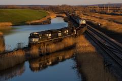 Turning Right at Tifft Street (Ryan J Gaynor) Tags: railroad reflection yard train pond buffalo lowlight railway trains railfan goldenhour causeway norfolksouthern railroading tifftstreet lakeeriedistrict