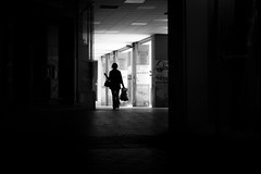 Move out of the shadows into the limelight [explored] (Thomas Demeulemeester) Tags: blackandwhite bw espaa woman byn blancoynegro monochrome silhouette backlight shopping bag europe noiretblanc tags murcia column dem 2016