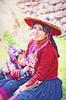 Lunch Break (Artypixall) Tags: portrait woman baby texture peru breastfeeding nursing pisac faa traditionalcostumes