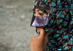 a bandari woman wearing a traditional mask called the burqa at panjshambe bazar thursday market, Hormozgan, Minab, Iran (Eric Lafforgue) Tags: people woman face horizontal outdoors persian clothing asia veil mask iran market muslim islam religion hijab culture persia headshot hidden covered iranian bazaar adults adultsonly oneperson islamic traditionaldress burqa customs ethnicity middleeastern sunni burka chador 20sadult youngadultwoman balouch hormozgan onewomanonly burqua  bandari  1people  iro thursdaymarket  minab colourpicture  borqe panjshambe panjshambebazar boregheh iran034i2922