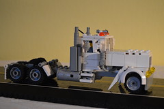 28 - White Long Nose Semi (Buff83ST) Tags: city west scale wheel america truck out nose layout coast town us cabin long flat lego cab united transport style semi camion american hauling hood states minifig heavy load loads trucking transporter sleeper fifth haul minifigure lkw hauler cabover flatnose schwertransport sattelschlepper auflieger sattelauflieger sattelzug 40tonner rmorque vierzigtonner