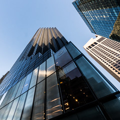 Trump tower, NYC (nianci pan) Tags: city nyc blue sky urban reflection building glass metal skyline modern skyscraper outdoor manhattan sony 5thavenue lookingup pan trumptower  modernarchitecture   sonyalphadslr  nianci sonyphotographing