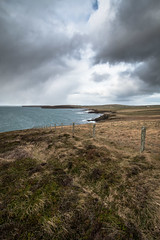 Withered (MBDGE) Tags: sea cliff cloud seascape water grass squall fence landscape islands scotland orkney wind heather wave canon70d