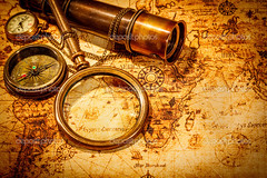 Vintage magnifying glass lies on an ancient world map (Mishal Ahmed) Tags: world voyage old travel sea brown abstract art history classic metal century vintage paper gold design search ancient marine tour treasure map antique background object grunge style rope science retro canvas equipment business direction telescope journey instrument geography concept nautical discovery success tool navigation compass grungy navigate antiquity charred bygone