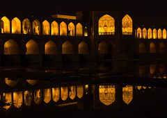 a view of the khaju bridge at night highlighting the arches, Isfahan Province, isfahan, Iran (Eric Lafforgue) Tags: city travel bridge urban reflection building tourism horizontal architecture night buildings outdoors persian asia arch iran middleeast bridges engineering persia arches nobody landmark architectural illuminated civil iranian centralasia esfahan isfahan ispahan إيران иран イラン irão isfahanprovince khajubridge 伊朗 colourpicture 이란 hispahan iran034i3527