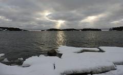 Ray of sunshine (KaarinaT) Tags: morning snow ice sunrise finland helsinki cloudy matosaari
