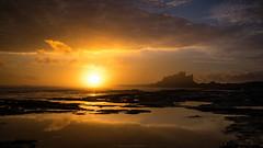 Bamburgh Castle (Manadh) Tags: sea castle clouds sunrise landscape rocks pentax sigma northumberland bamburgh k3 bamburghcastle 1835mm bamburghbeach manadh