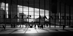 Stationshal (zsnajorrah) Tags: shadow sky people urban blackandwhite netherlands monochrome silhouette architecture clouds skyscraper rotterdam text indoor trainstation highrise weena rotterdamcentraal millenniumtoren 7dmarkii ef1635mmf4l