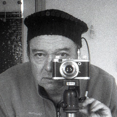 reflected self-portrait with Diax camera and black sequined hat (square crop) (pho-Tony) Tags: walter white black film monochrome square leaf grain rangefinder german voss rodinal expired f28 45mm ulm 1949 viewfinder synchro sx jessops kreuznach xenar compur pan400 45cm diax jessopspan400 synchrocompur jessopspan400sx cameraselfportraits shutterschneiderkreuznach schneiderkreuznachschneider 12435mm