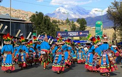 Illimani Guardian Mountain Morenada Street Dancing La Paz Bolivia South America (eriagn) Tags: street city travel blue winter red people music white mountain snow motion hot men southamerica glitter spectacular landscape happy photography gold costume team movement women friend shoes dancers dancing outdoor embroidery turquoise vibrant district traditional crowd families steps feathers culture photojournalism makeup vivid style peak sunny competition celebration bowlerhat heat signage sharing laughter procession tradition textiles sequence sequins festa lapaz cultural rhea highaltitude gaiety spectacle unison illimani morenada photoreportage intangibleculturalheritage eriagn ngairehart illimaniguardianmountain