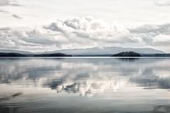 Little Fluffy Clouds (stephen cosh) Tags: reflection water clouds mediumformat scotland unitedkingdom gb lochlomond luss landscapeseascape stephencosh leicas006 100mmsummicrons