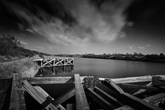 Derelict jetty on the Ship Canal (explored) (another_scotsman) Tags: longexposure urban blackandwhite monochrome landscape derelict manchestershipcanal