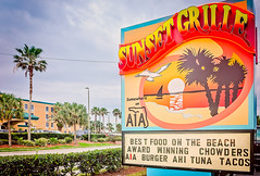 Sunset Grille sign in St. Augustine Florida (CarmenSisson) Tags: road street vacation food usa beach sign writing advertising outside typography restaurant florida tacos culture diner advertisement palmtrees burgers roadsigns ahituna chowder staugustine a1a sunsetgrille floridaa1a somewhereona1a a1alife haveana1aday