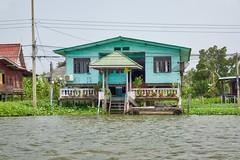 Houses on Ko Kret, an island in the Chao Phraya river near Bangkok, Thailand (UweBKK ( 77 on )) Tags: houses house water architecture river thailand flow island asia bangkok sony ko southeast alpha dslr chao koh 77 slt pak kret phraya kokret kohkret pakkret