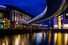 IMAX and the bridge (tom.leuzi) Tags: city longexposure bridge blue urban reflection water architecture night 35mm copenhagen wasser nacht shift architektur 1970 blau brcke kopenhagen manualfocus kbenhavn langzeitbelichtung schneiderkreuznach fisketorvet vintagelens shiftlens curtagon canoneos6d cykelslangen schneiderkreuznachpacurtagonr35mmf4