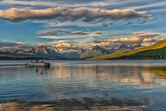Bliss (Philip Kuntz) Tags: sunset reflections evening boat fishing montana fishermen sundown dusk glacier glaciernationalpark bliss pontoonboat continentaldivide apgar partyboat lakemcdonald