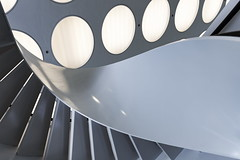 Curl up (Maerten Prins) Tags: new light white abstract building netherlands lamp composition nijmegen circle campus spiral stair university circles nederland stairwell lamps curve universiteit rhythm upshot curvelicious grotiusgebouw